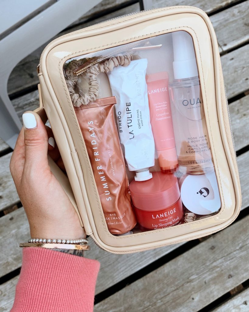 Clear travel cosmetics bag by Beis