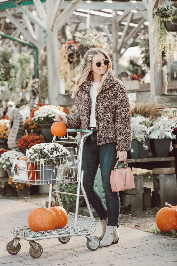 Shopping for pumpkins in a leopard puffer jacket by Noize Original