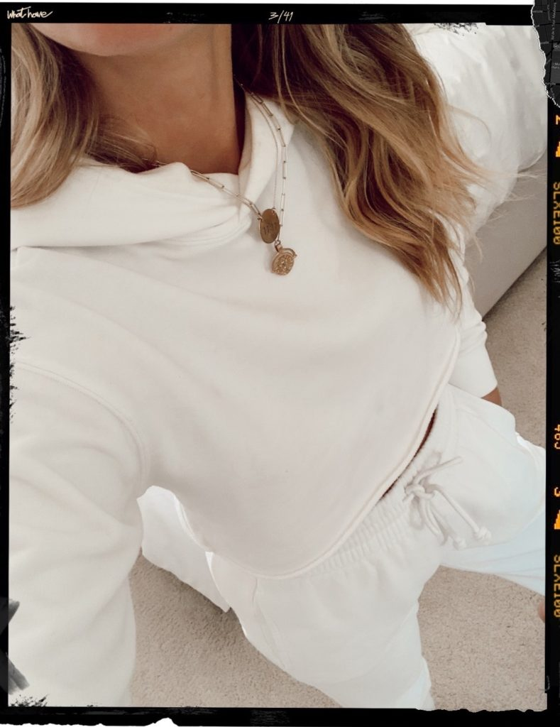 white sweat set including white joggers and white cropped hoodie